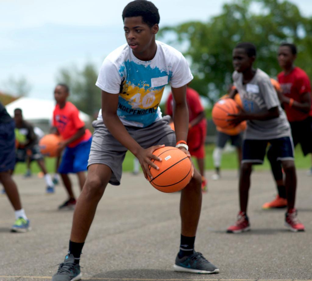 Boys play basketball