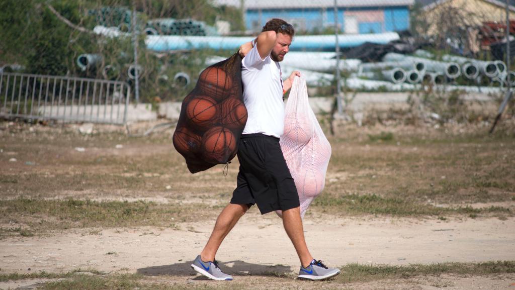 Coach carrying balls