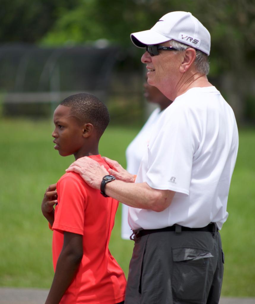 Coach Sam with camper